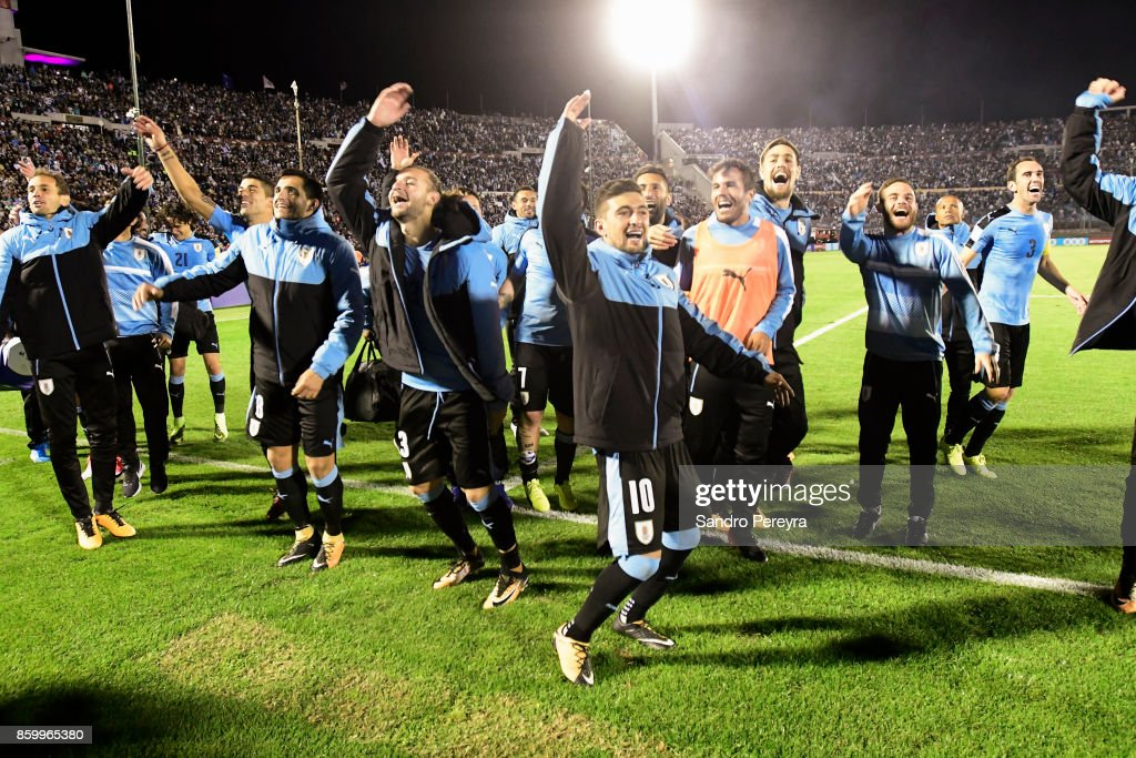 Players of Uruguay celebrate the victory and qualifying to the World Cup after a match between Uruguay and Bolivia as part of FIFA 2018 World Cup Qualifiers at Centenario Stadium on October 10, 2017 in Montevideo, Uruguay.