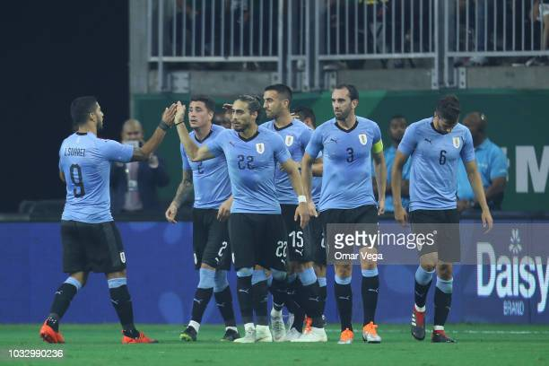 Players of Uruguay celebrate their first goal during the International Friendly match between Mexico and Uruguay at NRG Stadium on September 7 2018...