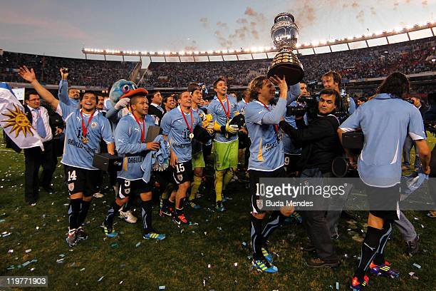 Players of Uruguay celebrate title during the Copa America 2011 final match between Uruguay and Paraguay at Monumental Antonio Vespucio Liberti...
