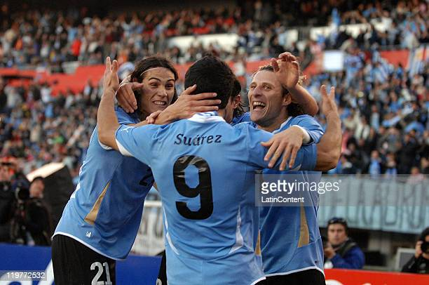 Players of Uruguay Luis Suarez Edinson Cavani and Diego Forlan celebrate their victory at the Copa America 2011 against Paraguay at Antonio Vespucio...