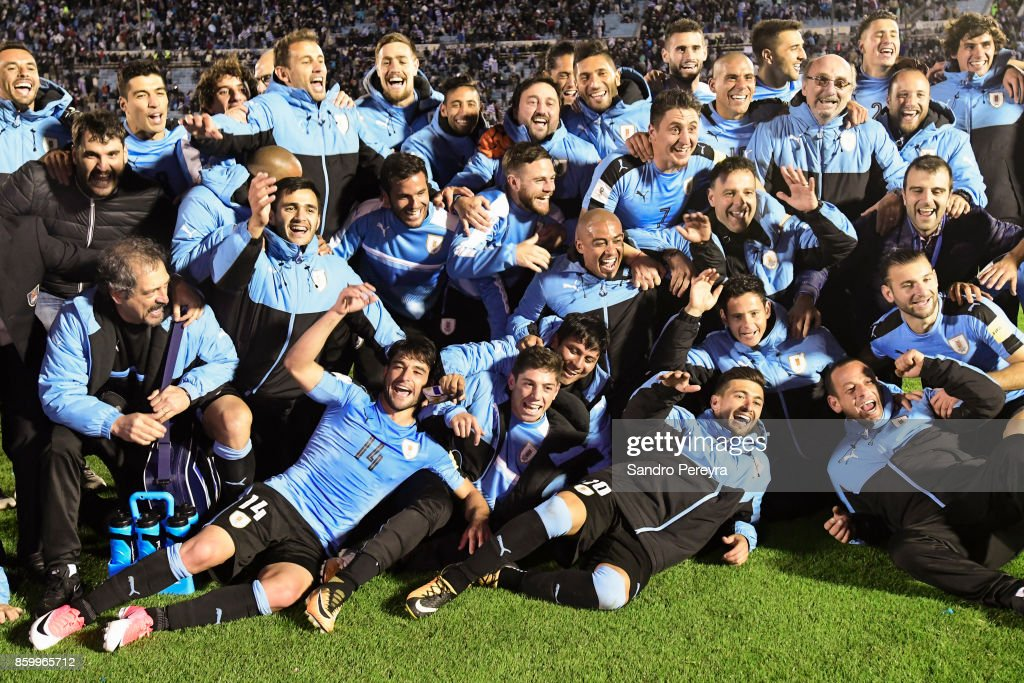 Players of Uruguay pose for photos and celebrate the victory and qualifying to the World Cup after a match between Uruguay and Bolivia as part of FIFA 2018 World Cup Qualifiers at Centenario Stadium on October 10, 2017 in Montevideo, Uruguay.