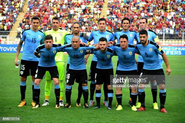 Players of Uruguay pose for pictures before the start of their 2018 World Cup qualifier football match against Venezuela in San Cristobal Venezuela...