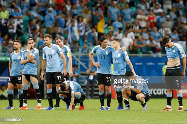 Players of Uruguay react during a penalty shootout after the Copa America Brazil 2019 quarterfinal match between Uruguay and Peru at Arena Fonte Nova...