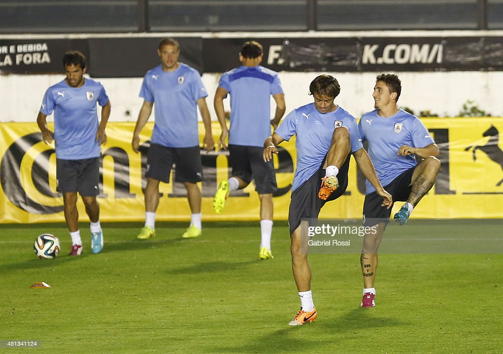 Players of Uruguay stretch out during a training session as part of the 2014 FIFA World Cup on June 27, 2014 in Rio de Janeiro, Brazil. Uruguay will face Colombia in a Round of 16 match as part of FIFA World Cup 2014 Brazil at Sao Januario Stadium on June 28.