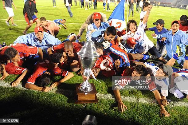 Players of Uruguayan football team Nacional celebrate after obtaining the Apertura tournament at the Centenario stadium in Montevideo on December 10...