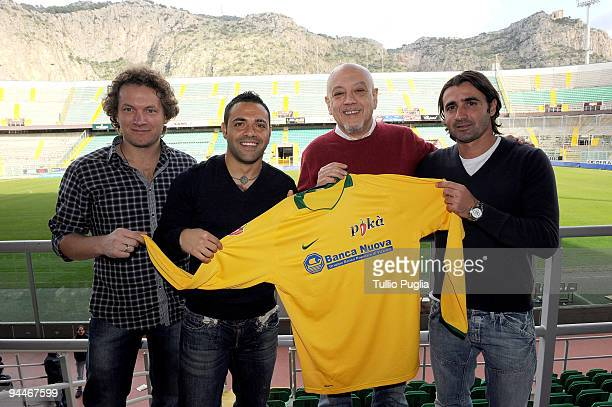 Players of US Citta di Palermo Fabrizio Miccoli and Giovanni Tedesco and singers Matteo Becucci and Enrico Ruggeri present the official jersey during...