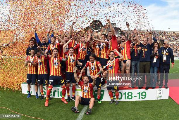 Players of US Lecce celebrate second place in the Serie B championship and promotion in the Serie A championship after the Serie B match between US...