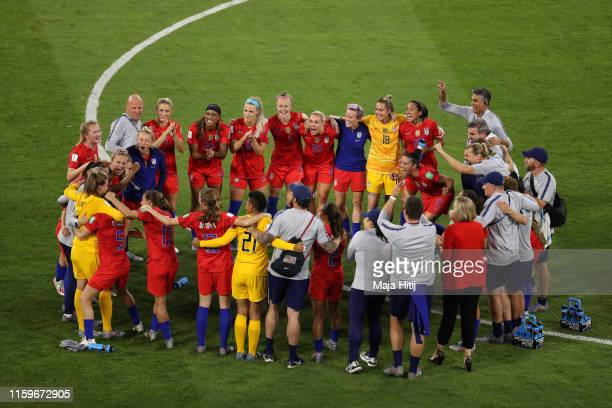 Players of USA celebrate on the pitch together following victory in the 2019 FIFA Women's World Cup France Semi Final match between England and USA...