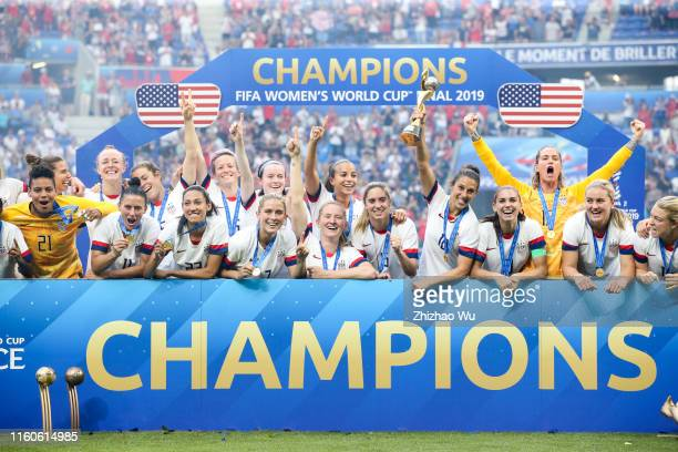Players of USA celebrate the champions during award ceremony of the 2019 FIFA Women's World Cup France Final match between The United State of...