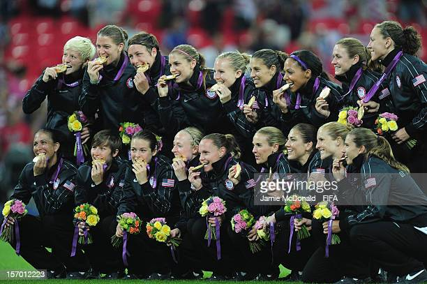 Players of USA celebrate with their Gold Medals during the Women's Football Gold Medal match between USA and Japan on Day 13 of the London 2012...