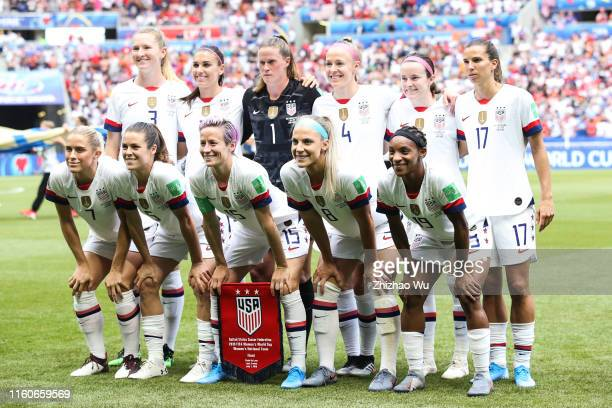 Players of USA line up for team photos prior to the 2019 FIFA Women's World Cup France Final match between The United State of America and The...