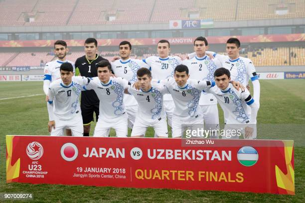 Players of Uzbekistan line up for team photos prior to AFC U23 Championship Quarterfinal between Japan and Uzbekistan at Jiangyin Sports Center on...