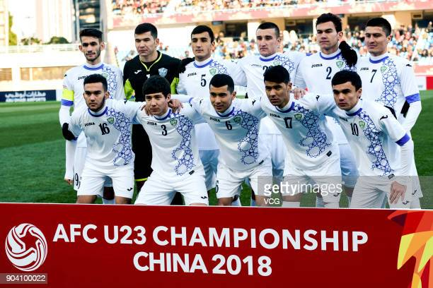 Players of Uzbekistan line up prior to the AFC U23 Championship Group A match between Uzbekistan and China at Changzhou Olympic Sports Center on...