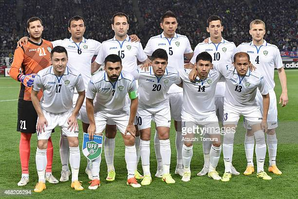 Players of Uzbekistan line up prior to the match during the international friendly match between Japan and Uzbekistan at Ajinomoto Stadium on March...
