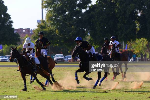 Players of V Polo and Golden Globe teams in action during the 'Rajmata Gayatri Devi Memorial Cup' polo match at Polo ground in...