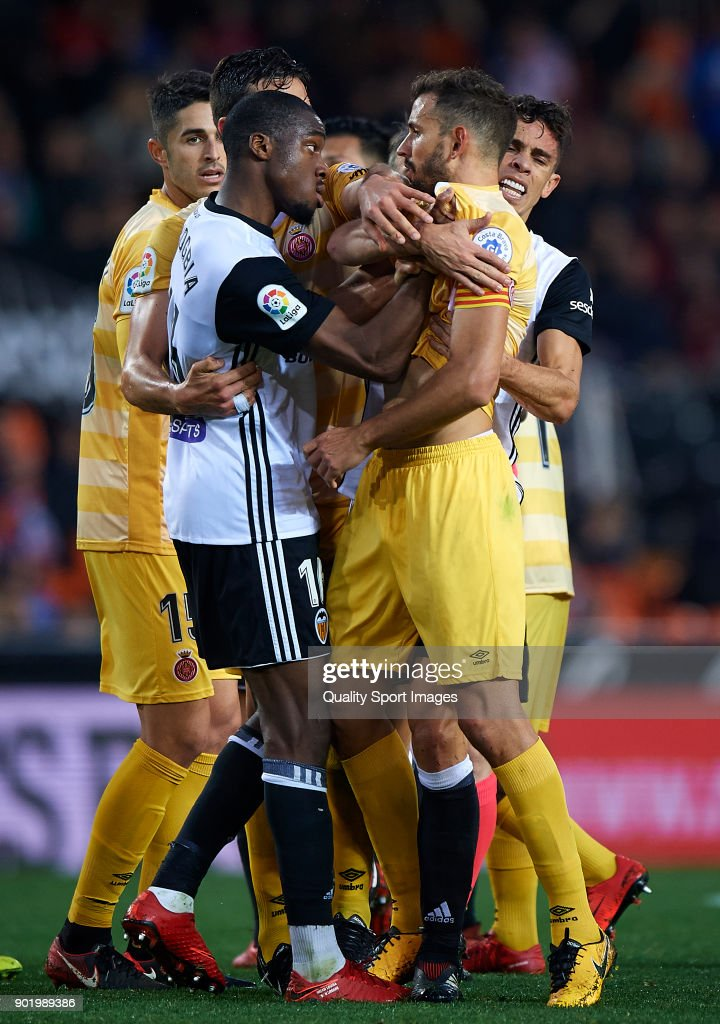 Players of Valencia and Girona scuffle during the La Liga match between Valencia and Girona at Mestalla stadium on January 6, 2018 in Valencia, Spain.