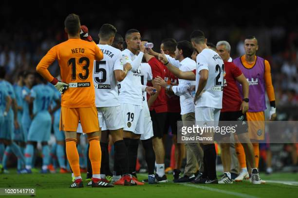 Players of Valencia drink water during a break due to hot temperatures during the La Liga match between Valencia CF and Club Atletico de Madrid at...