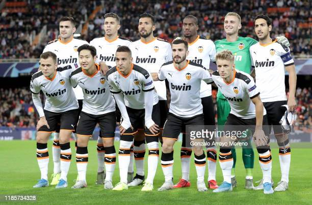Players of Valencia pose for a team photo prior to the UEFA Champions League group H match between Valencia CF and Lille OSC at Estadio Mestalla on...