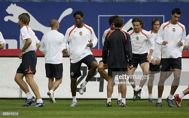 Players of Valencia warm up during a press conference and training session for FC Valencia for the Intertoto Cup Final between Hamburger SV and FC...
