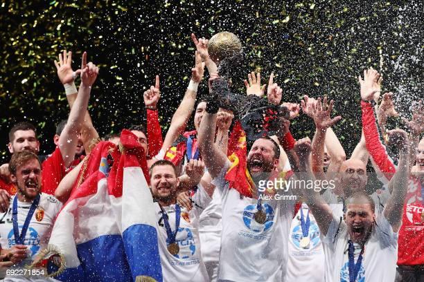 Players of Vardar celebrate with the trophy after winning the VELUX EHF FINAL4 final between Paris SaintGermain Handball and HC Vardar at Lanxess...