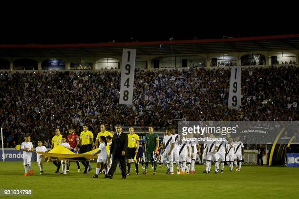 Players of Vasco da Gama and Universidad de Chile enter the field before a Group Stage match between Vasco and Universidad de Chile as part of Copa...