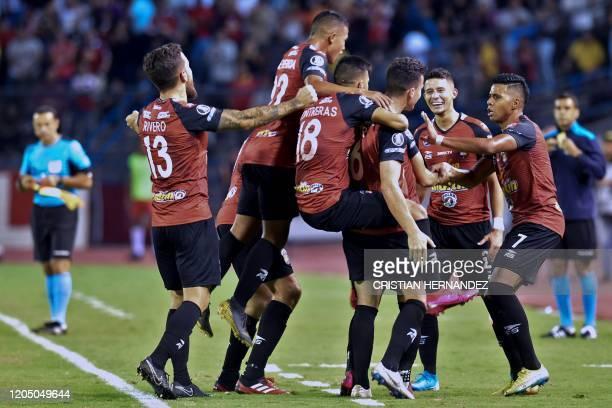 Players of Venezuela' Caracas celebrate after teammate Robert Hernandez scored against Argentina's Boca Juniors during their Copa Libertadores...