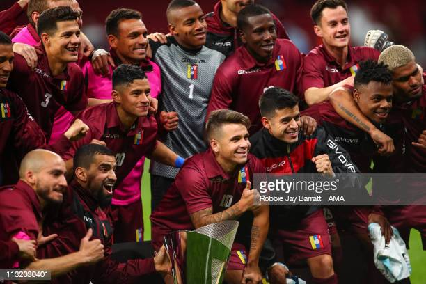 Players of Venezuela celebrate with the Adidas Cup at full time during the International Friendly match between Argentina and Venezuela at Estadio...