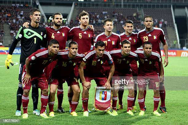 Players of Venezuela pose for a team photo prior a match between Venezuela and Peru as part of the 16th round of the South American Qualifiers at...