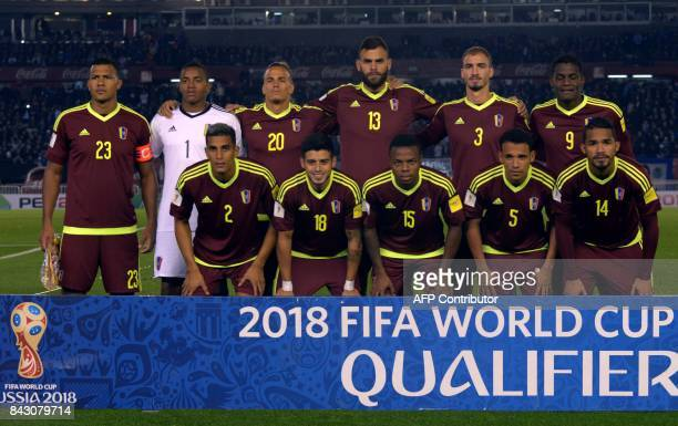 Players of Venezuela pose for pictures before the start of their FIFA 2018 World Cup qualifier football match against Argentina in Buenos Aires on...