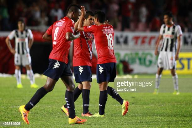 Players of Veracruz celebrate the first goal of his team during a match between Tiburones Rojos and Rayados de Monterrey as part of 4th round...