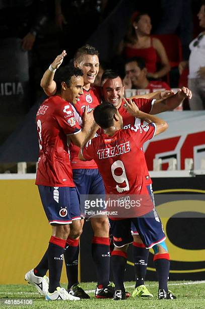 Players of Veracruz celebrate the second goal during a 1st round match between Veracruz and Chivas as part of the Apertura 2015 Liga MX at Luis...