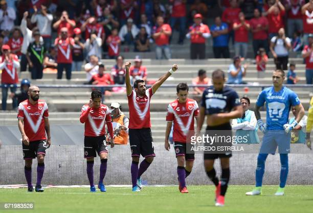 Players of Veracruz celebrate their second goal against Pumas during their Mexican Clausura 2017 tournament football match at the Olimpico...