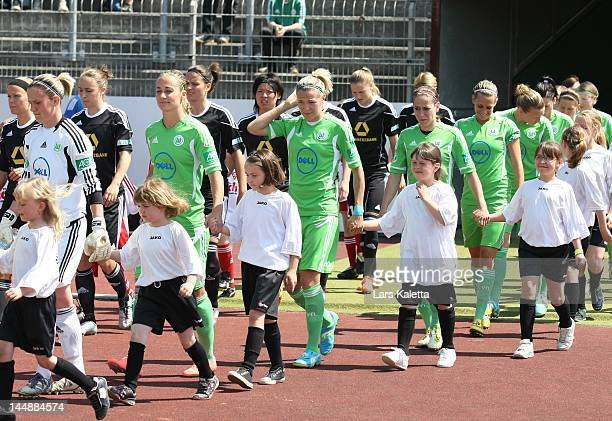 Players of VfL Wolfsburg and 1 FFC Frankfurt walk onto the pitch prior the Women's Bundesliga match between VfL Wolfsburg and 1 FFC Frankfurt on May...