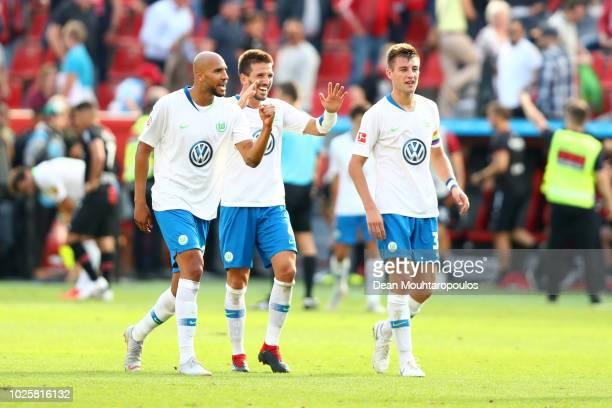 Players of VfL Wolfsburg celebrate following their sides victory in the Bundesliga match between Bayer 04 Leverkusen and VfL Wolfsburg at BayArena on...