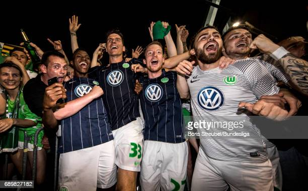 Players of VfL Wolfsburg celebrate the continuance in the first Bundesliga after winning the Bundesliga Playoff Leg 2 match between Eintracht...