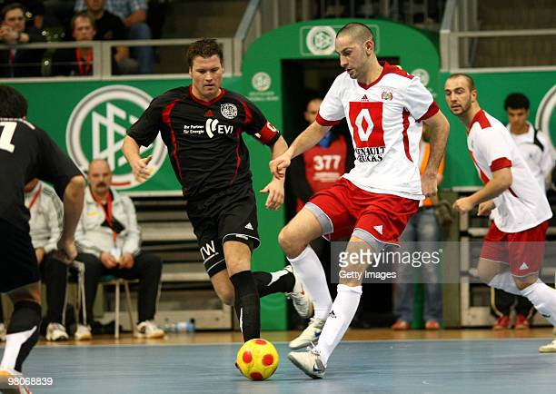Players of VfV 06 Borussia Hildesheim and MSV Hamburg battle for the ball during the DFB futsal cup at the LausitzArena on March 26 2010 in Cottbus...