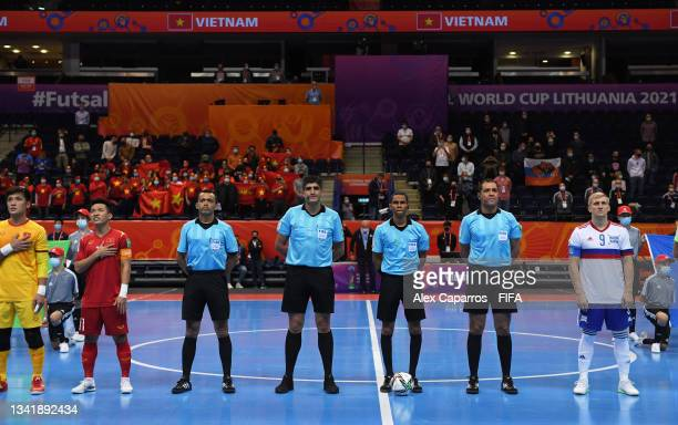 Players of Vietnam and Football Union of Russia line up alongside the Match Officials ahead of the FIFA Futsal World Cup 2021 Round of 16 match...
