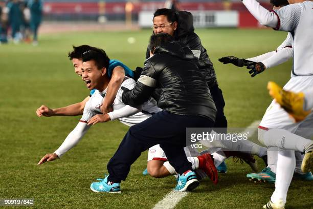 Players of Vietnam celebrate after winning the AFC U23 Championship semifinal match between Qatar and Vietnam at Changzhou Olympic Sports Center on...