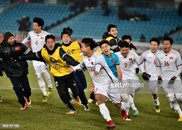 Players of Vietnam celebrate after winning the AFC U-23 Championship semi-final match between Qatar and Vietnam at Changzhou Olympic Sports Center on...
