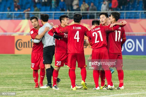 Players of Vietnam celebrate during the AFC U23 Championship Group A match between Vietnam and Australia at Kunshan Stadium on January 14 2018 in...