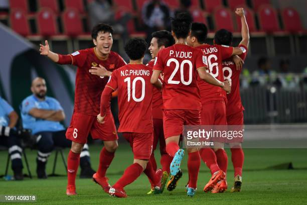 Players of Vietnam celebrate their side's first as an own goal scored by Ali Faez of Irak during the AFC Asian Cup Group D match between Iraq and...