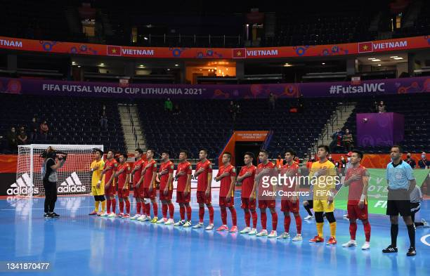 Players of Vietnam line up ahead of the FIFA Futsal World Cup 2021 Round of 16 match between Football Union of Russia and Vietnam at Vilnius Arena on...