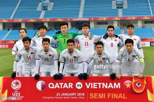 Players of Vietnam line up prior to the AFC U23 Championship semifinal match between Qatar and Vietnam at Changzhou Olympic Sports Center on January...
