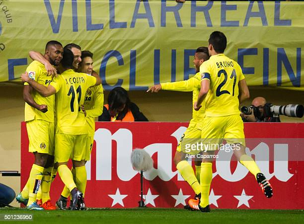 Players of Villarreal CF celebrate after their teammate Roberto Soldado scored the opening goal during the La Liga match between Villarreal CF and...