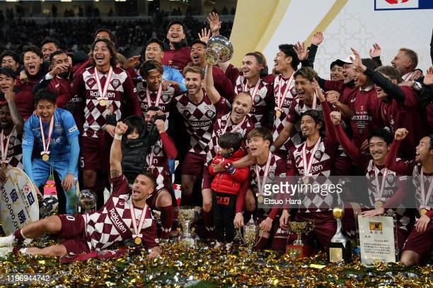 Players of Vissel Kobe celebrate the victory as captain Andres Iniesta lifts the trophy after the 99th Emperor's Cup final between Vissel Kobe and...