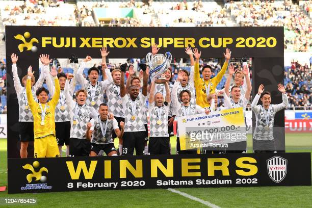 Players of Vissel Kobe celebrate with the trophy after winning the match during the Xerox Super Cup between Yokohama F.Marinos and Vissel Kobe at...