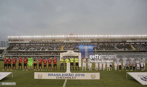 Players of Vitoria and Santos pose for photo before the match between Santos and Vitoria for the Brazilian Series A 2016 at Vila Belmiro stadium on...