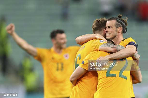 Players of Wales celebrate their victory at the end of the EURO 2020 Group A soccer match between Turkey and Wales at the Baku Olympic Stadium in...
