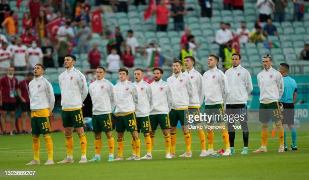Players of Wales turn to sing the national anthem prior to the UEFA Euro 2020 Championship Group A match between Turkey and Wales at Baku Olimpiya...