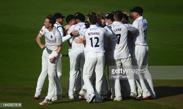 Players of Warwickshire celebrate the final celebrates the final wicket of Jack Brooks of Somerset to win the County Championship following Day Four...